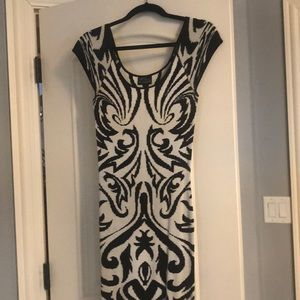 Tight stretchy torn multi black and white dress